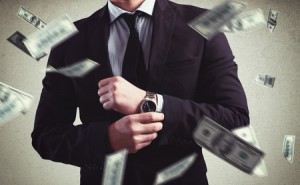 56470691 - rich man with clock and money background